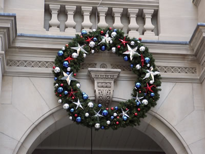 Round Christmas Wreath on public building