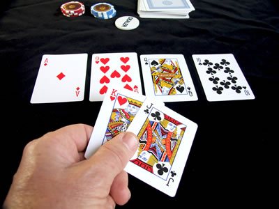 Poker hand, ace high straight.