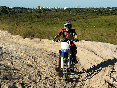 motor bike. Dirt Bike rider wearing safety gear and helmet.
